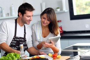 couple-in-the-kitchen-using-tablet