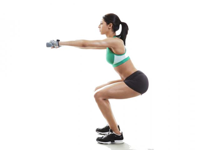 woman_doing_squat__medium_4x3